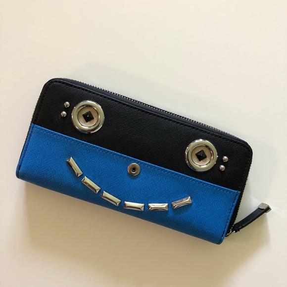 04d67f09c6 Calvin Klein Handbags - Calvin Klein saffiano happy face wallet